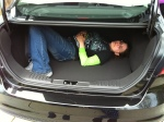 My sister-in-law tests out the trunk.